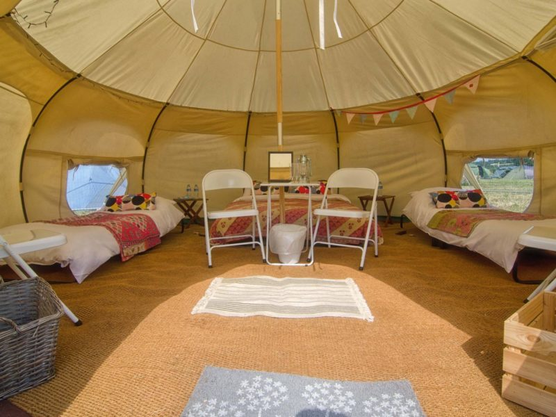 comfortable-camping-in-a-lotus-belle-tent